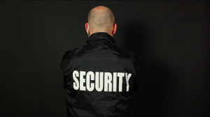 Security in bomber jacket